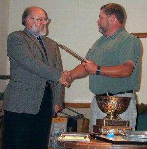 OCOA President McMullen presents awards to Al Farrer