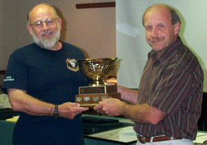 Farrer received award from Serge Tenaglia, Director of MNR Enforcement Branch
