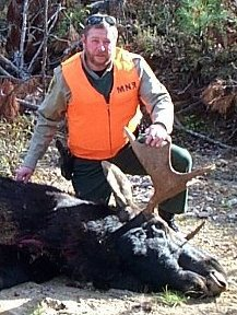 CO Slater investigating a moose kill